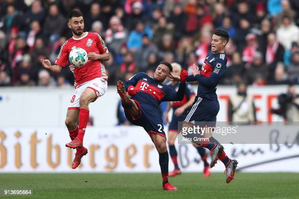 Gerrit Holtmann of Mainz Tolisso of Bayern Muenchen and James Rodriguez of Bayern Muenchen fight for the ball during the Bundesliga match between 1...