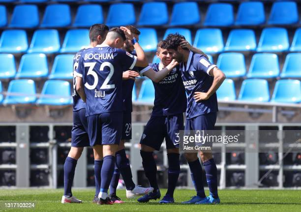 Gerrit Holtmann of VfL Bochum 1848 celebrates after scoring their sides third goal with team mates during the Second Bundesliga match between VfL...