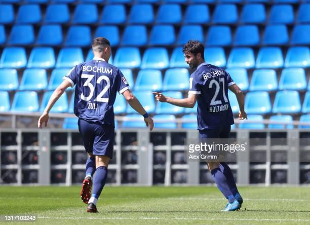 Gerrit Holtmann of VfL Bochum 1848 celebrates after scoring their sides third goal with team mate Robert Žulj during the Second Bundesliga match...