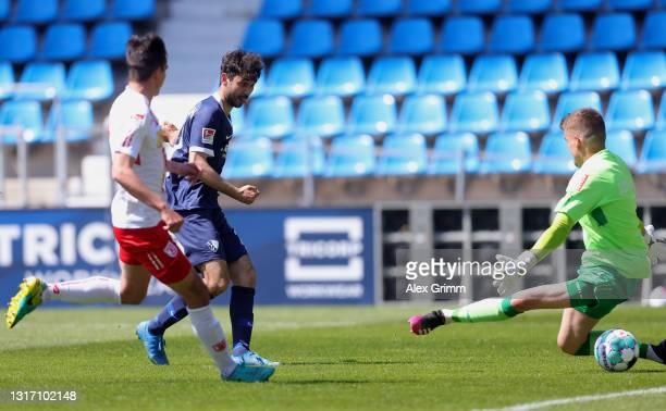Gerrit Holtmann of VfL Bochum scores their sides third goal past Alexander Meyer of Jahn Regensburg during the Second Bundesliga match between VfL...