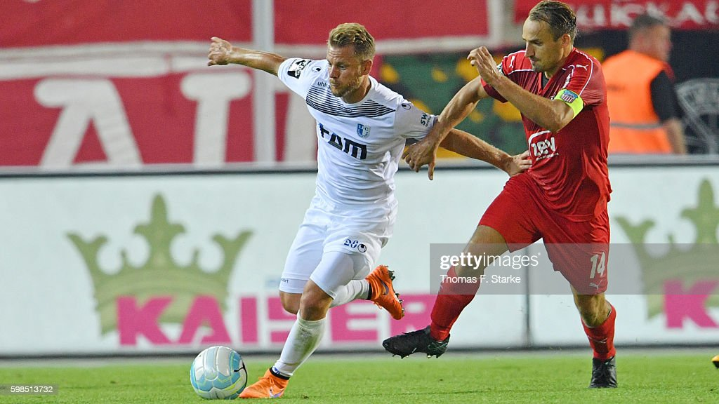 Gerrit Mueller (L) of Magdeburg and Toni Wachsmuth of Zwickau fight for the ball during the Third League match between FSV Zwickau and 1. FC Magdeburg at Stadion Zwickau on September 1, 2016 in Zwickau, Germany.