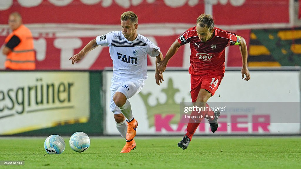 Gerrit Mueller (L) of Magdeburg and Toni Wachsmuth of Zwickau react as a second ball is thrown on the pitch during the Third League match between FSV Zwickau and 1. FC Magdeburg at Stadion Zwickau on September 1, 2016 in Zwickau, Germany.