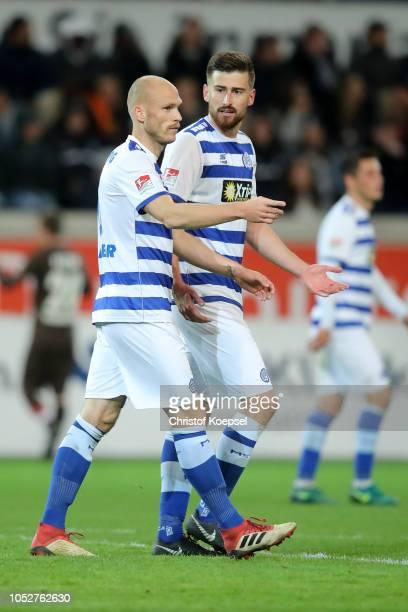 Gerrit Nauber and Dustin Bomheuer look dejected during the Second Bundesliga match between MSV Duisburg and FC St Pauli at SchauinslandReisenArena on...