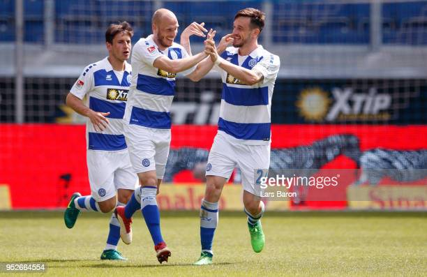 Gerrit Nauber of Duisburg celebrates with team mates after scoring his teams first goal during the Second Bundesliga match between MSV Duisburg and...
