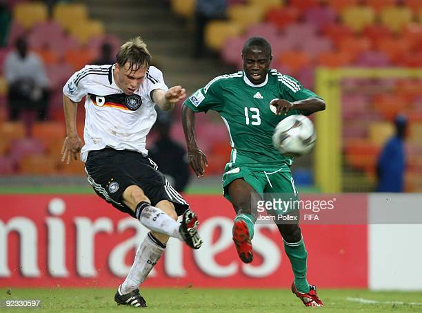 Gerrit Nauber of Germany and Omoh Ojabu of Nigeria battle for the ball during the FIFA U17 World Cup Group A match between Nigeria and Germany at the...