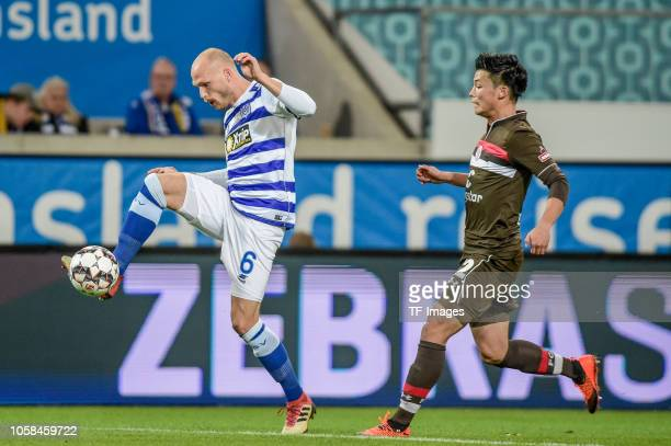 Gerrit Nauber of MSV Duisburg and Ryo Miyaichi of St Pauli battle for the ball during the Second Bundesliga match between MSV Duisburg and FC St...