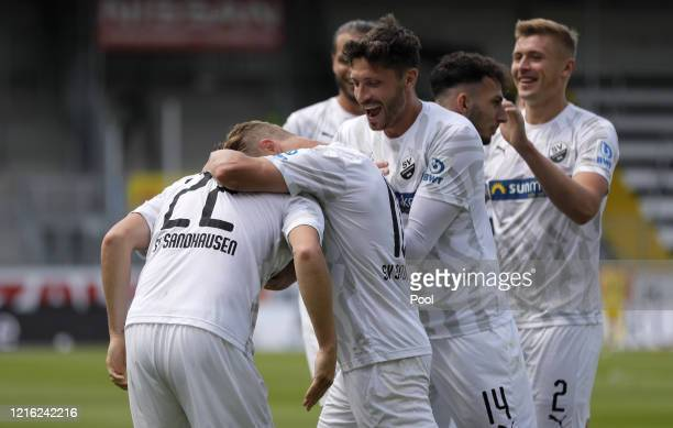 Gerrit Nauber of Sandhausen celebrates with team mates after scoring his sides second goal during the Second Bundesliga match between SV Sandhausen...