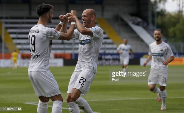 Gerrit Nauber of Sandhausen celebrates with teammate Leart Paqarada after scoring his sides second goal during the Second Bundesliga match between SV...