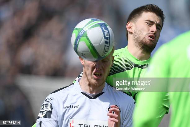 Gerrit Wegkamp of Aalen competes with Dustin Bomheuer of Duisburg during the third league match between VfR Aalen and MSV Duisburg at ScholzArena on...