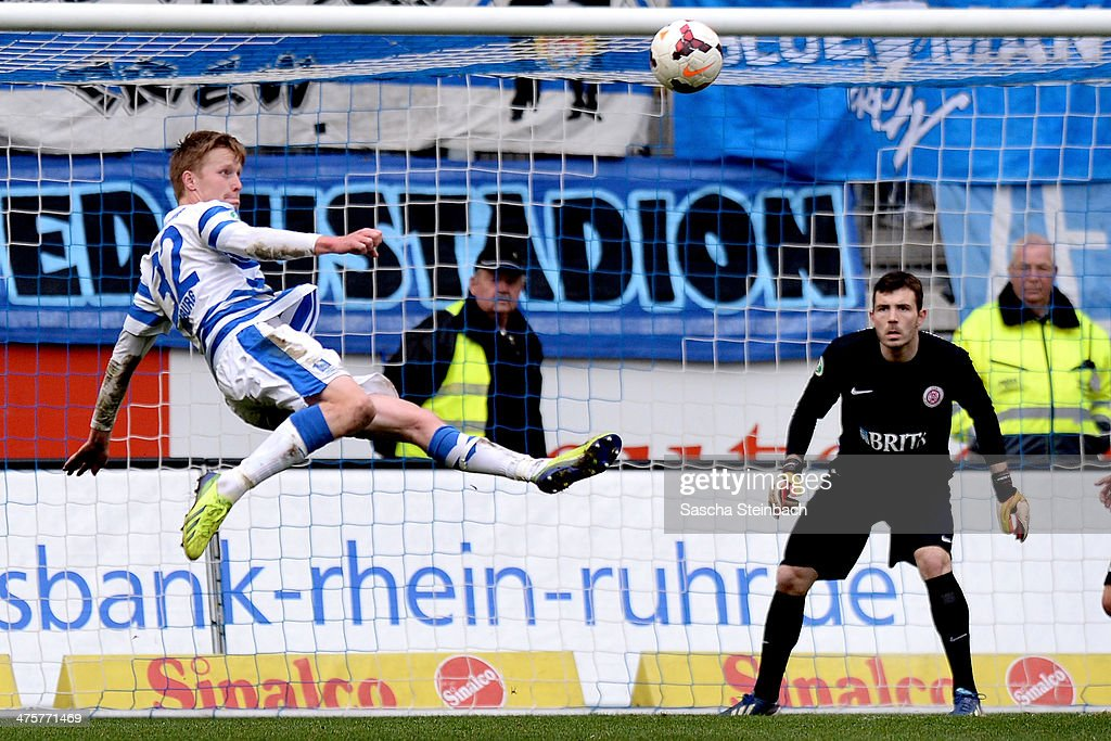 Gerrit Wegkamp (L) of Duisburg misses a chance at goal during the 3. Liga match between MSV Duisburg and SV Wehen Wiesbaden at Schauinsland-Reisen-Arena on March 1, 2014 in Duisburg, Germany.