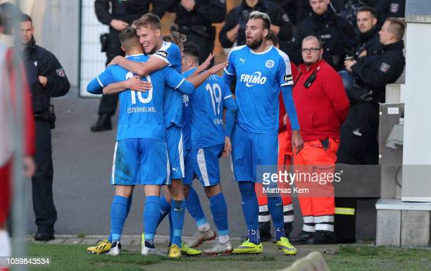 Gerrit Wegkamp of Lotte celebrates with teammates after scoring his team's second goal during the 3. Liga match between FC Energie Cottbus and VfL...
