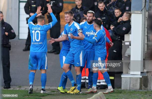 Gerrit Wegkamp of Lotte celebrates with teammates after scoring his team's second goal during the 3 Liga match between FC Energie Cottbus and VfL...