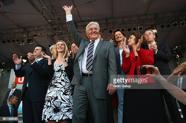 Gerrman Vice Chancellor, Foreign Minister and lead candidate of the German Social Democrats Frank-Walter Steinmeier waves while standing with his...