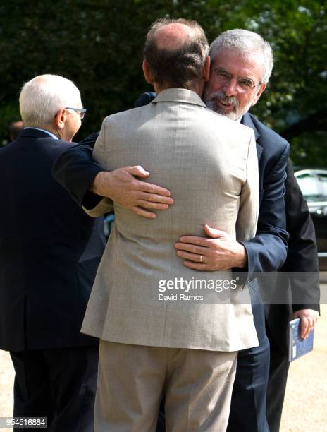 Gerry Adams former leader of Sinn Fein greets Brian Currin member of the International Contact Group as he arrives at the international event to...