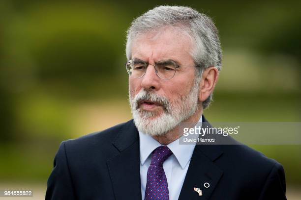 Gerry Adams former leader of Sinn Fein hugs Brian Currin looks on during the International event to advance in the resolution of the conflict in the...