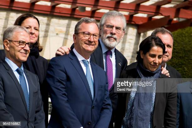 Gerry Adams former leader of Sinn Fein poses alongside members of the International Contact Group during an international event to advance the...