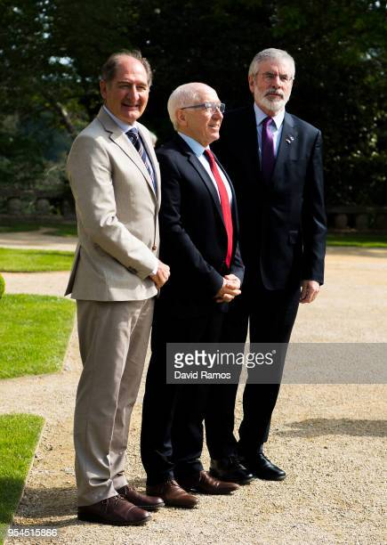 Gerry Adams former leader of Sinn Fein poses next to Brian Currin member of the International Contact Group and JeanRene Etchegaray Mayor of Baiona...