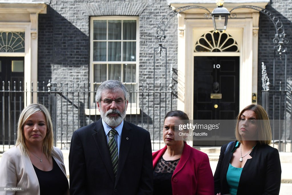 Gerry Adams, President of Sinn Féin (2nd L) and Michelle O'Neill, leader of Sinn Féin (L) stand with colleagues as they speak to the media outside 10 Downing Street on June 15, 2017 in London, England. Prime Minister Theresa May held a series of meetings with the main Northern Ireland political parties today to allay mounting concerns over a government deal with the DUP in the wake of the UK general election.