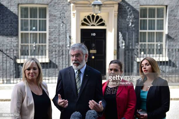 Gerry Adams, President of Sinn Féin and Michelle O'Neill, leader of Sinn Féin stand with colleagues as they speak to the media outside 10 Downing...