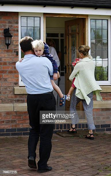 Gerry and Kate McCann carry their twin children into the house after arriving back at the family home in Rothley Leicestershire 09 September 2007 The...