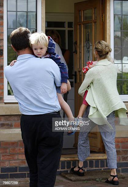 Gerry and Kate McCann carry their twins Amelie and Sean into the house after arriving back at the family home in Rothley Leicestershire 09 September...