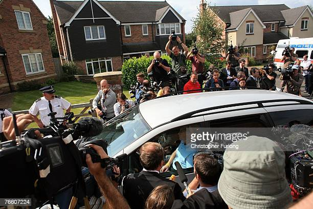 Gerry and Kate McCann drive past the media as they arrive home on September 9 2007 in Rothley England The McCann family have returned from Portugal...