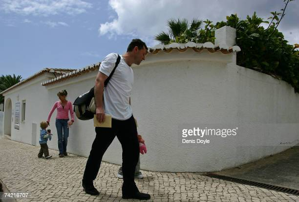 Gerry and Kate McCann the parents of the missing British girl Madeleine collect their children Amelie and Sean from the local nursery on May 22 2007...