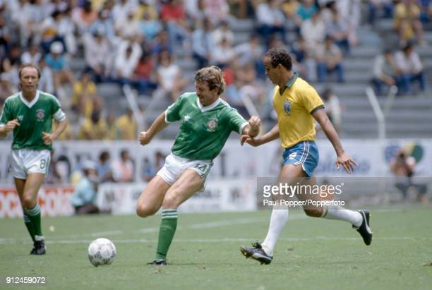 Gerry Armstrong of Northern Ireland is challenged by Elzo of Brazil during the FIFA World Cup match between Northern Ireland and Brazil at the...