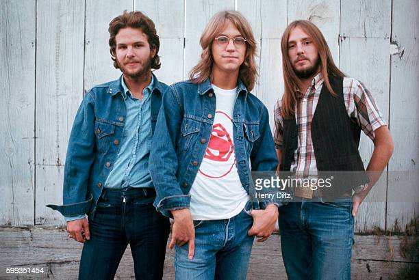Gerry Beckley Dewey Bunnel and Dan Peek of folkrock trio America stand by a wall America is best remembered for the anthemic 'A Horse with no Name'
