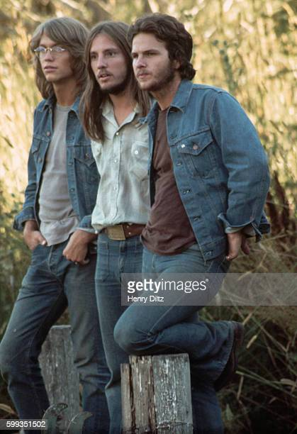 Gerry Beckley Dewey Bunnel and Dan Peek of folkrock trio America stand in a field America is best remembered for the anthemic 'A Horse with no Name'