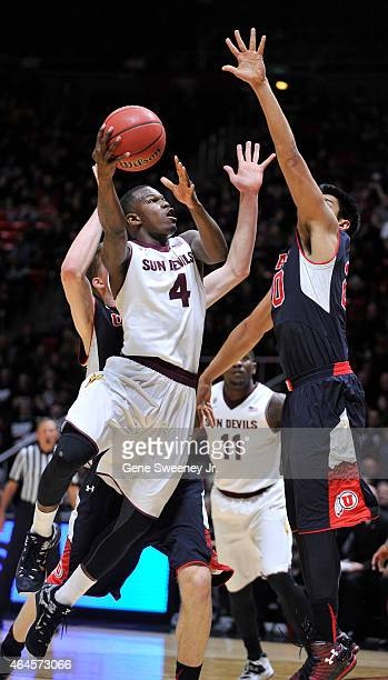 Gerry Blakes of the Arizona State Sun Devils goes up for a shot against defender Chris Reyes of the Utah Utes during first half action at the Jon M...