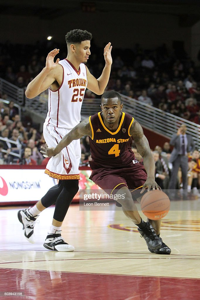 Gerry Blakes #4 of the Arizona State Sundevils handles the ball against Benny Boatwright #25 of the USC Trojans during a NCAA Pac12 college basketball game at Galen Center on January 7, 2016 in Los Angeles, California.
