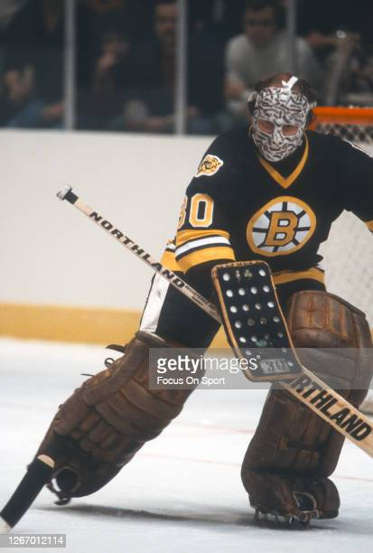 Gerry Cheevers of the Boston Bruins defends his goal against the New York Rangers during an NHL Hockey game circa 1978 at Madison Square Garden in...