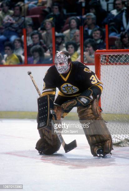 Gerry Cheevers of the Boston Bruins defends his goal against the Philadelphia Flyers during an NHL Hockey game circa 1980 at The Spectrum in...