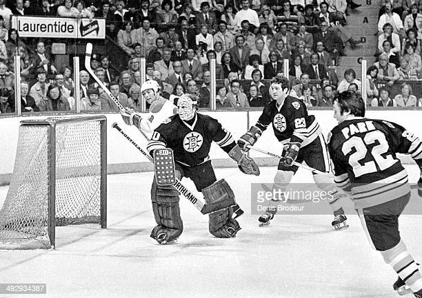 Gerry Cheevers of the Boston Bruins protects the net during a game against the Montreal Canadiens at the Montreal Forum circa 1970 in Montreal,...