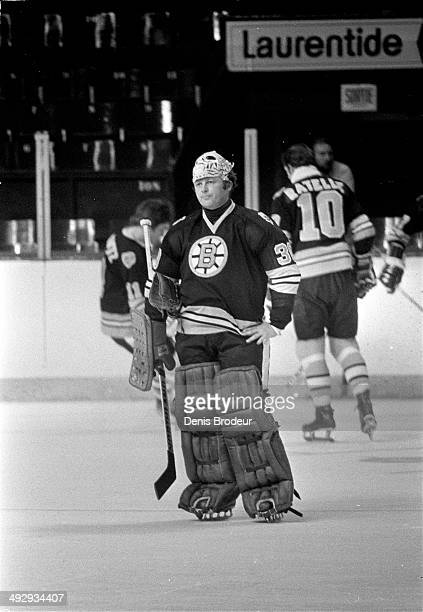Gerry Cheevers of the Boston Bruins stands on the ice before a game against the Montreal Canadiens at the Montreal Forum circa 1970 in Montreal,...