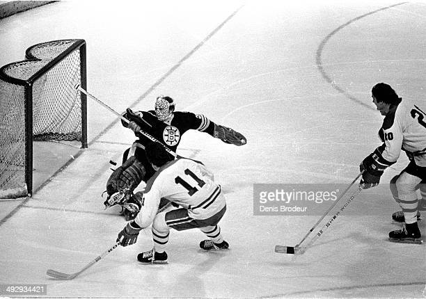 Gerry Cheevers of the Boston Bruins tries to make a save during a game against the Montreal Canadiens at the Montreal Forum circa 1970 in Montreal,...