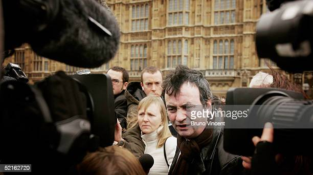 Gerry Conlon speaks to the press with Bridie Brenan as they arrive at the Houses of Parliament February 9 2005 in London British Prime Minister Tony...