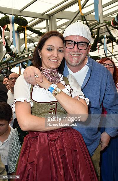 Gerry Friedle and his wife Sonja Kien pose at Schottenhamel beer tent during the Oktoberfest 2015 Opening at Theresienwiese on September 19 2015 in...