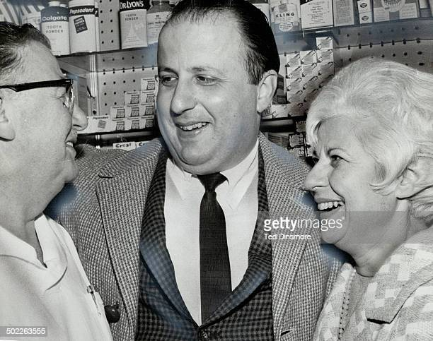 Gerry Fromstein who won $52000 today in the Irish sweepstake drops in on his parents Mr and Mrs Harry Fromstein at his father's drugstore The younger...