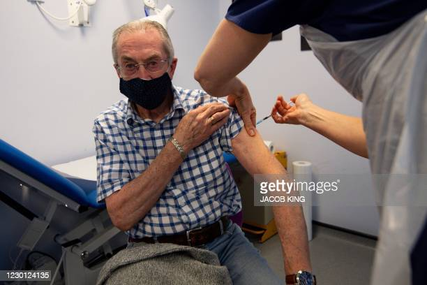 Gerry Hughes wearing a protective face covering to combat the spread of the coronavirus, receives a dose of the Pfizer-BioNtech covid-19 vaccine, the...