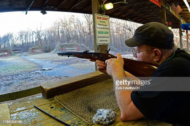 Gerry Lee practices his shooting skills at Clark Brothers' gun store and shooting range in Warrenton Virginia some 48 miles from Washington DC on...