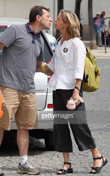 Gerry McCann and wife Kate parents of missing fouryearold Briton Madeleine McCann kiss before she enters the headquarters of Policia Judiciaria...