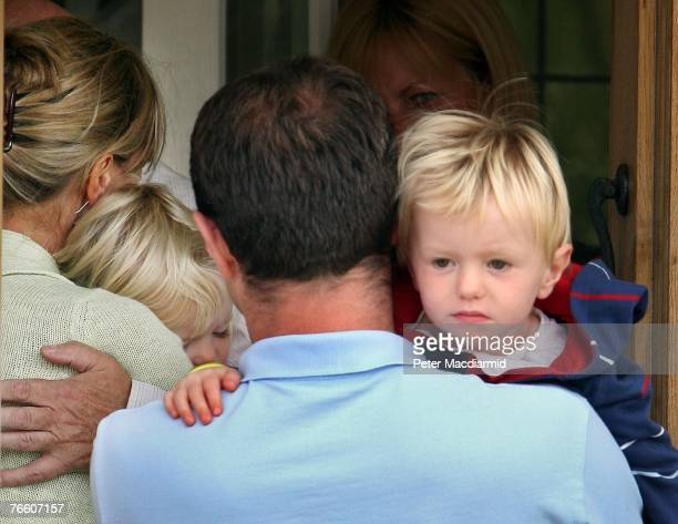 Gerry McCann arrives home carrying his son Sean as his wife Kate holds her daughter Amelie as she hugs a relative on September 9 2007 in Rothley...