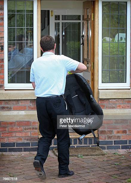 Gerry McCann carries a baby seat as he arrives home on September 9 2007 in Rothley England The McCann family have returned from Portugal after local...