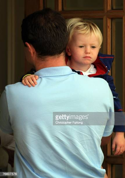 Gerry McCann carries his son Sean on arrival at home on September 9 2007 in Rothley England The McCann family have returned from Portugal after local...
