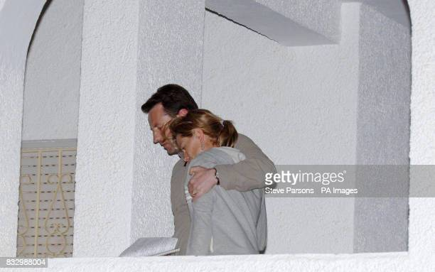 Gerry McCann consoles his wife Kate after giving a statement to the press in the Algarve village of Praia Da Luz where their daughter threeyearold...