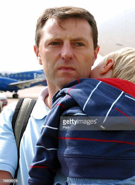 Gerry McCann father of missing fouryearold Madeleine McCann arrives back in the UK to East Midlands airport with son Sean after taking a flight from...