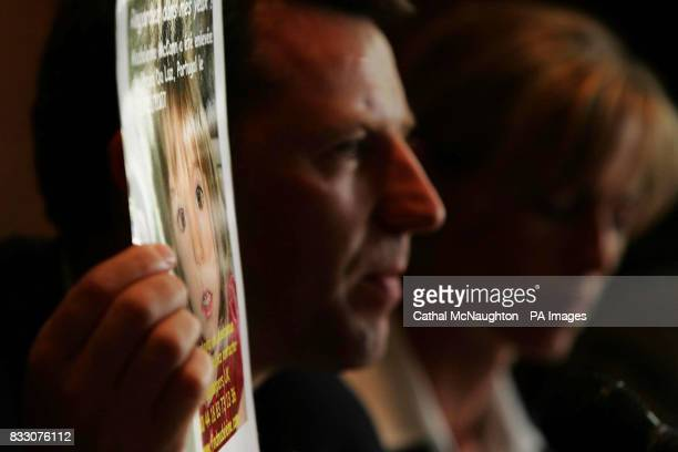 Gerry McCann holds up a picture of his missing daughter Madeleine during a press conference in the Hilton Hotel Rabat during their visit to Morocco...