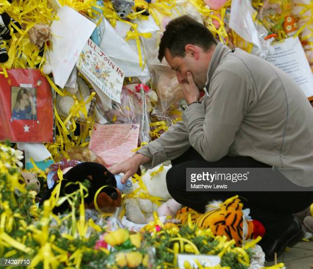 Gerry McCann reads messages in support for his daughter Madeleine McCann at the War memorial in Rothley Village Centre on May 21 2007 in Rothley...